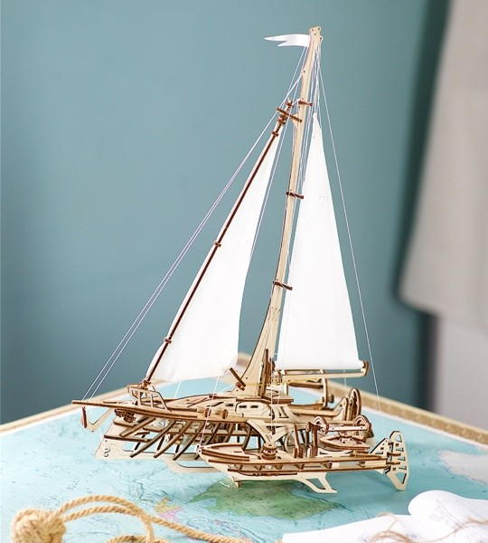 Ugears mechanical model kit Trimaran Merihobus and wooden 3D puzzle. Bench model of multihull sailboat with winches, rigging, bulkheads, frames and beams and hulls, model for self-assembly. Original gift for boys and girls and smart hobby for grown-ups.